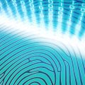 Fingerprints against a blue background and encrpytion symbols to represent Biometrics