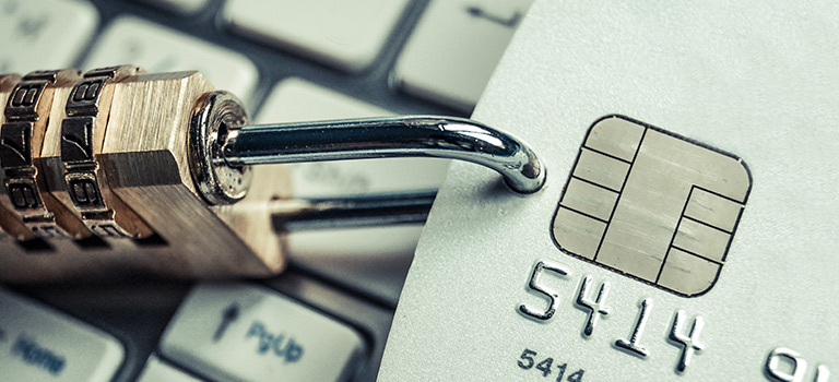 Cybersecurity Vulnerabilities lock on credit card on keyboard