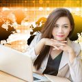 Confident business woman using computer