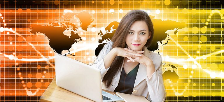 Confident business woman using computer against a backdrop of a map, staring confidently to address the gender gap
