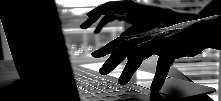 Cybersecurity attacks, black and white, criminal typing on keyboard, cyber attack