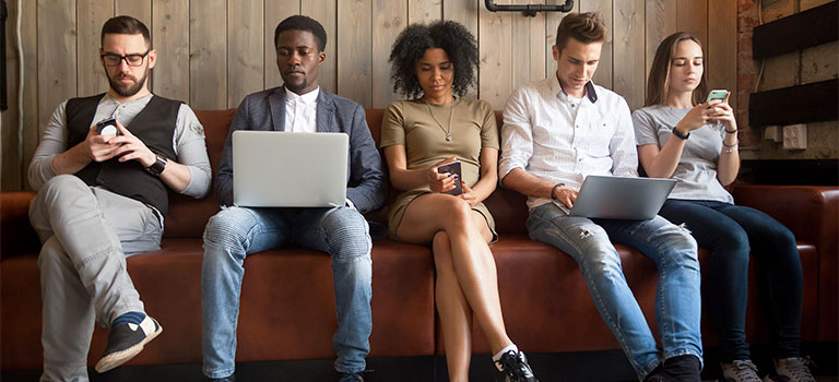 Millennials on their phones Cybersecurity