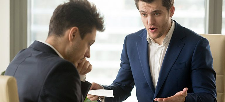 Employee Reporting boss yelling at employee business attire