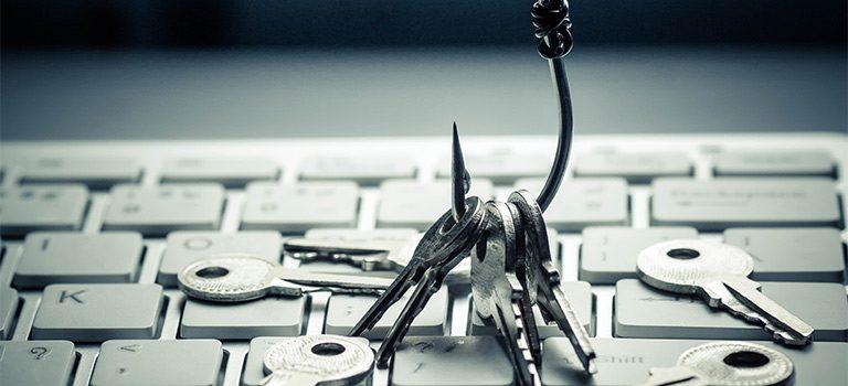 Keys on fishing hook over keyboard, concept social phishing