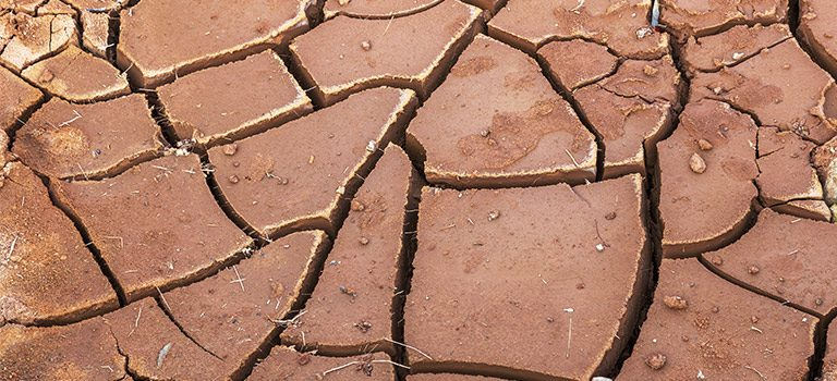 Cybersecurity Drought. Dry Bottom Of The Lake. Dead Dry Land From Drought. Dry Fissured Drought Soil. The Concept