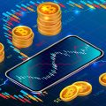 cryptocurrency abstract, phone with bitcoins around it, graphs, blue