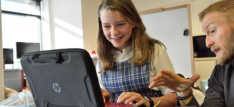 Cybersecurity Teach to Kids girl on Computer Education Classroom Teacher